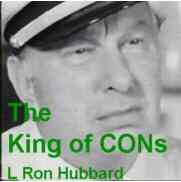 picture of a scowling L Ron Hubbard